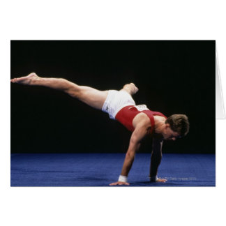 Male gymnast peforming a routine in the floor card
