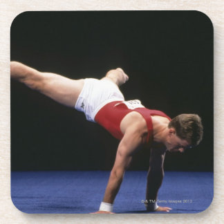 Male gymnast peforming a routine in the floor coaster