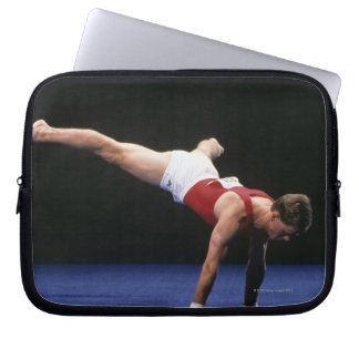 Male gymnast peforming a routine in the floor laptop computer sleeve