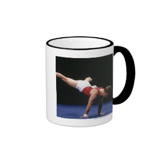 Male gymnast peforming a routine in the floor coffee mug