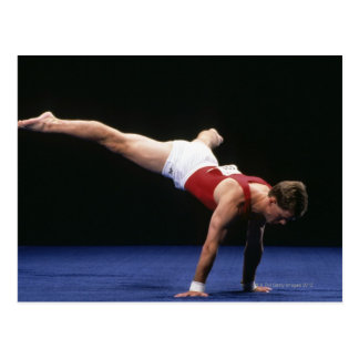 Male gymnast peforming a routine in the floor postcard