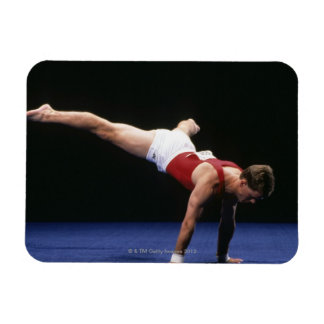 Male gymnast peforming a routine in the floor rectangular magnets