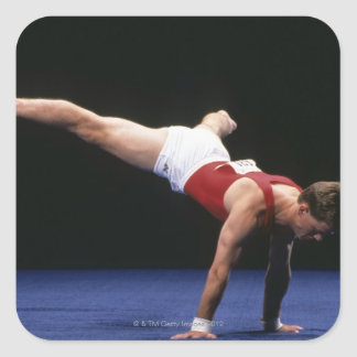 Male gymnast peforming a routine in the floor square sticker