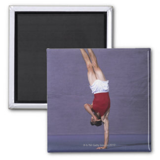 Male gymnast performing on the floor exercise 2 2 inch square magnet