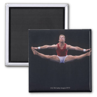 Male gymnast performing on the floor exercise 2 inch square magnet