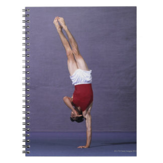 Male gymnast performing on the floor exercise 2 spiral notebook