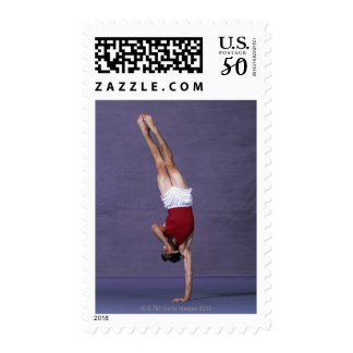 Male gymnast performing on the floor exercise 2 postage