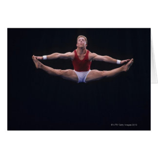 Male gymnast performing on the floor exercise card