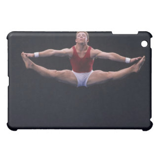Male gymnast performing on the floor exercise cover for the iPad mini