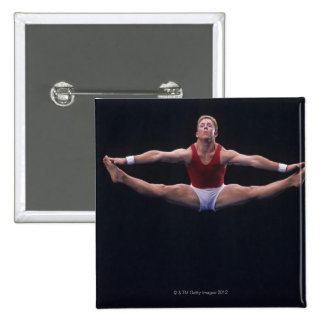 Male gymnast performing on the floor exercise pinback button