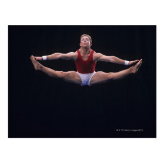 Male gymnast performing on the floor exercise postcard