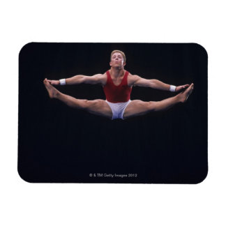 Male gymnast performing on the floor exercise rectangular photo magnet