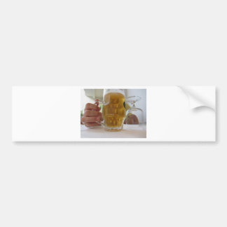 Male hand holding a cold mug of light beer bumper sticker