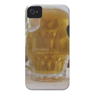 Male hand holding a cold mug of light beer iPhone 4 case
