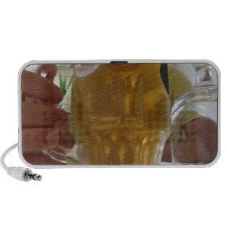 Male hand holding a cold mug of light beer portable speaker