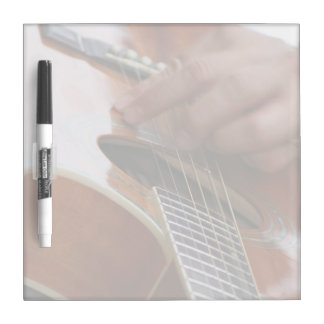 male hand holding pick on acoustic guitar Dry-Erase board