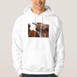 male hand holding pick on acoustic guitar hoodie