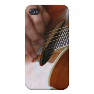 male hand holding pick on acoustic guitar cover for iPhone 4