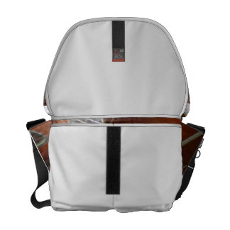 male hand holding pick on acoustic guitar messenger bags