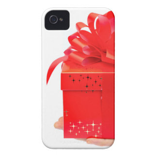 Male hand presenting red christmas box on hand iPhone 4 cover