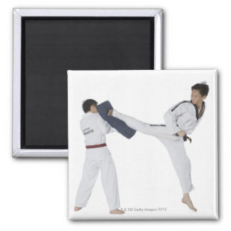 Male karate instructor teaching martial arts to 2 2 inch square magnet