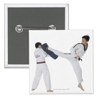 Male karate instructor teaching martial arts to 2 pinback button