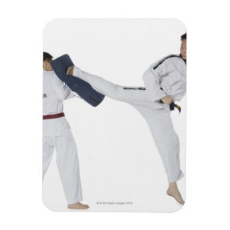 Male karate instructor teaching martial arts to 2 rectangular photo magnet
