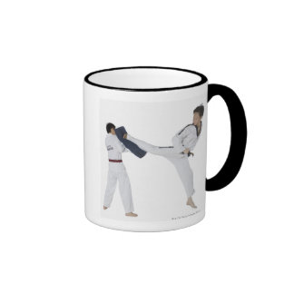 Male karate instructor teaching martial arts to 2 ringer mug