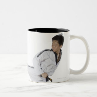 Male karate instructor teaching martial arts to 2 Two-Tone coffee mug