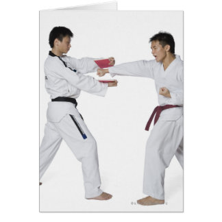 Male karate instructor teaching martial arts to card