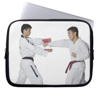 Male karate instructor teaching martial arts to laptop computer sleeve