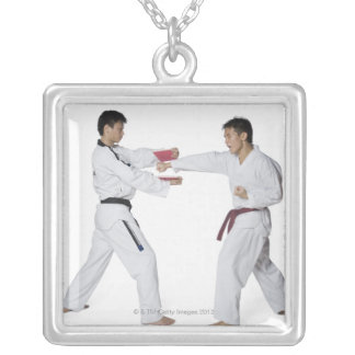 Male karate instructor teaching martial arts to pendants