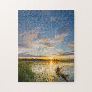 Male kayaker paddling sea kayak on still water jigsaw puzzle