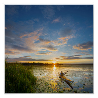 Male kayaker paddling sea kayak on still water poster