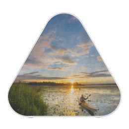 Male kayaker paddling sea kayak on still water speaker