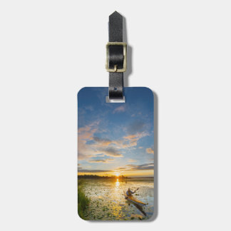 Male kayaker paddling sea kayak on still water tag for luggage