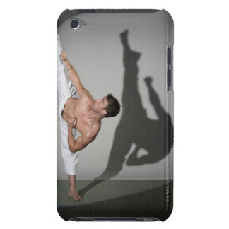 Male martial artist performing kick, studio shot iPod touch cases