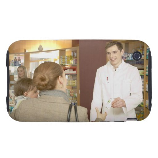 Male pharmacist handing medicine over to young tough iPhone 3 cover