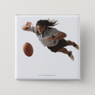 Male rugby player diving for ball pinback button