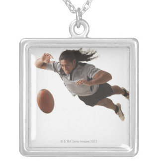 Male rugby player diving for ball silver plated necklace