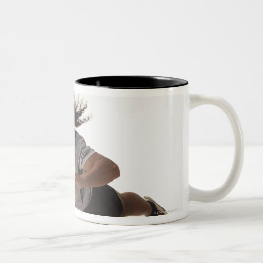 Male rugby player diving for ball Two-Tone coffee mug