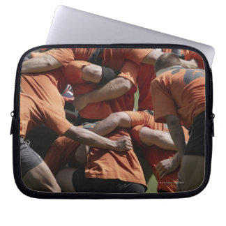Male rugby players in scrum, rear view laptop sleeve
