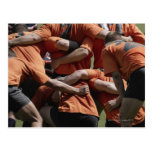 Male rugby players in scrum, rear view postcards
