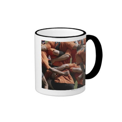 Male rugby players in scrum, rear view ringer mug