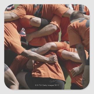Male rugby players in scrum, rear view square sticker