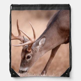 Male whitetail deer grazing drawstring bag