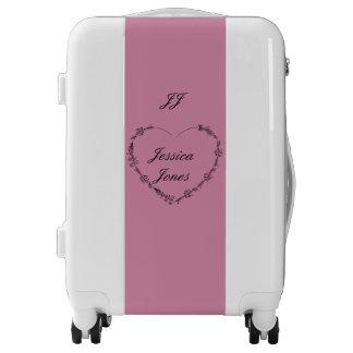 Maleta rosada blanca del equipaje de encargo del