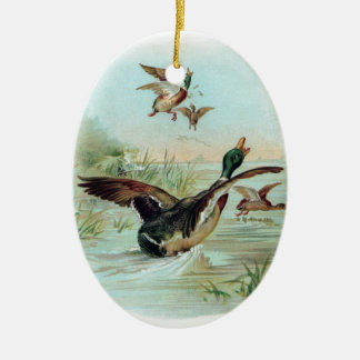 Mallard Making a Water Landing Double-Sided Oval Ceramic Christmas Ornament
