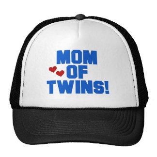 Mamá azul de gemelos gorras