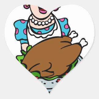 Mamá de la acción de gracias que sirve el disco de pegatina en forma de corazón